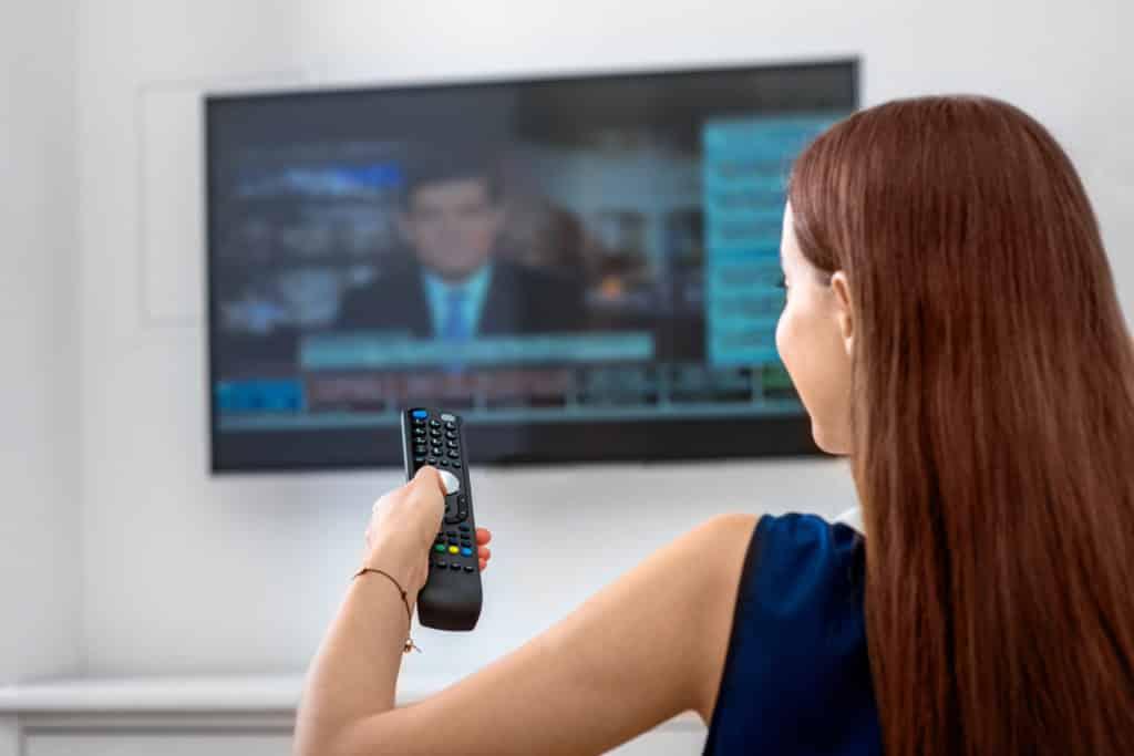 Woman watching TV in Wallingford, CT