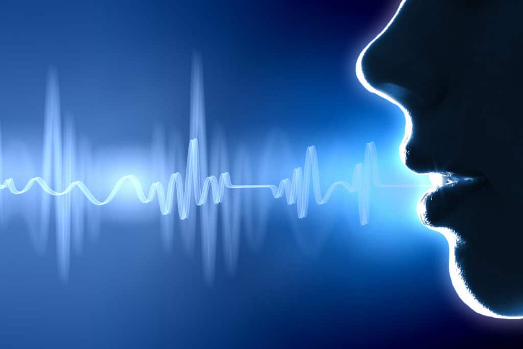 a sihlouette of a mouth with a blue sound wave coming from it